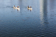 People in canoes on Lady Bird Lake in Austin, Texas