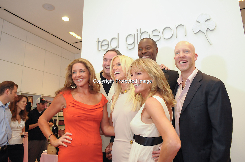 """090924-CHEVYCHASE-(L-R)Mary Amons, Tareq Salahi, Michaele Salahi, and Catherine Ommanney, casts member of the up and coming Bravo show """"The Real Housewives of DC,""""  pose for a photo with stylist Ted Gibson(2nd-L ) and his partner Jason Backe(R) during the grand opening of Gibson's new salon in Chevy Chase, Md on September 24, 2009."""