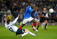 Fotball<br /> Foto: BPI/Digitalsport<br /> NORWAY ONLY<br /> <br /> Portsmouth v Leeds United<br /> Carling Cup third round. 26/10/2004.<br /> <br /> Aliou Cisse skips over the tackle from Danny Pugh