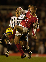 Picture: Henry Browne, Digitalsport<br /> Date: 23/01/2005.<br /> Arsenal v Newcastle United Barclays Premiership.<br /> Dennis Bergkamp tussles with Titus Bramble of Newcastle.