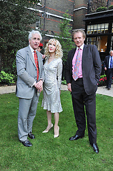 Left to right, HUGO VICKERS, and RICHARD & BASIA BRIGGS at a reception hosted by the Friends of the Castle of Mey held at the Goring Hotel, Beeston Place, London on 22nd May 2012.