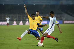 October 25, 2017 - Kolkata, West Bengal, India - England Rhain Brewster (jersey 9) and Brazil Vitao (jersey 3) in action during the FIFA U 17 World Cup India 2017 Semi Final match in Kolkata. Players of England and Brazil in action during the FIFA U 17 World Cup India 2017 Semi Final match on October 25, 2017 in Kolkata. (Credit Image: © Saikat Paul/Pacific Press via ZUMA Wire)