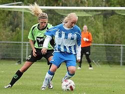 FODBOLD: Anette Ancker Jørgensen (Taastrup FC) og Louise Larsen (OB) under kampen i 3F Ligaen mellem Taastrup FC og OB den 12. maj 2012 i Taastrup Idrætspark. Foto: Claus Birch
