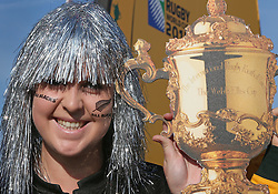 © Licensed to London News Pictures. 31/10/2015. London, UK. A New Zealand rugby fan poses for a trophy photo as she arrives for the Rugby World Cup final at Twickenham. Photo credit: Peter Macdiarmid/LNP