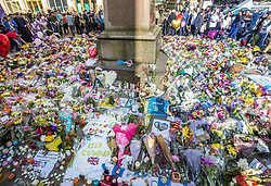 Floral tributes in St. Ann's Square, close to the Manchester Arena where a suicide bomber killed 22 people leaving a pop concert at the venue on Monday night.