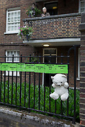 Childrens bears and cuddly toys and some of the victims names on railings near where the Grenfell fire occured, on the first anniversary of the tower block disaster, on 14th June 2018, in London, England. 72 people died when the tower block in the borough of Kensington & Chelsea were killed in what has been called the largest fire since WW2. The 24-storey Grenfell Tower block of public housing flats in North Kensington, West London, United Kingdom. It caused 72 deaths, out of the 293 people in the building, including 2 who escaped and died in hospital. Over 70 were injured and left traumatised. A 72-second national silence was held at midday, also observed across the country, including at government buildings, Parliament.
