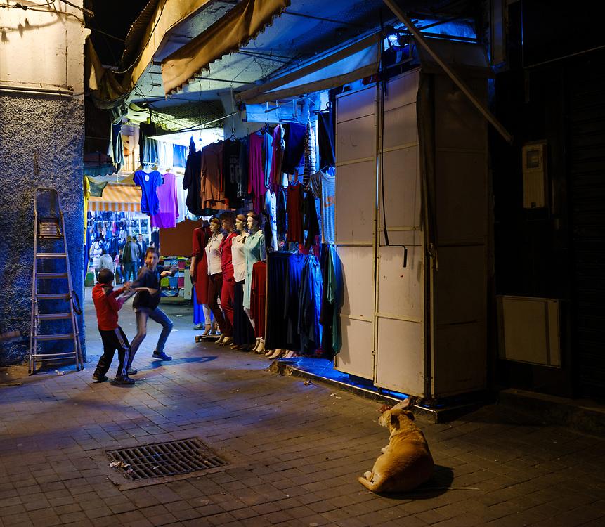 CASABLANCA, MOROCCO - CIRCA APRIL 2017: Kids playing at night in an alleyway of the Medina in  Casablanca