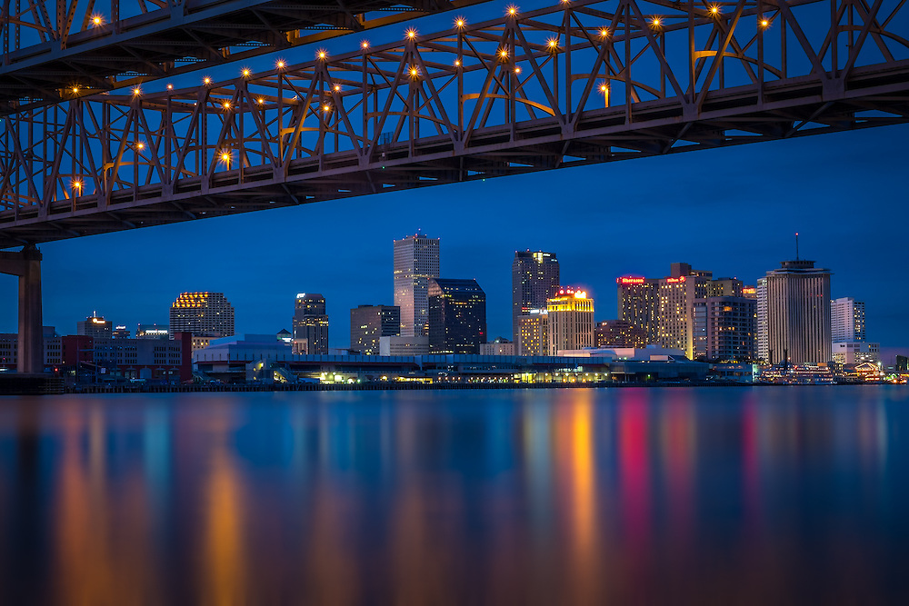 NEW ORLEANS - CIRCA FEBRUARY 2014: Night view of the Crescent City Connection over the Mississippi River and New Orleans Skyline