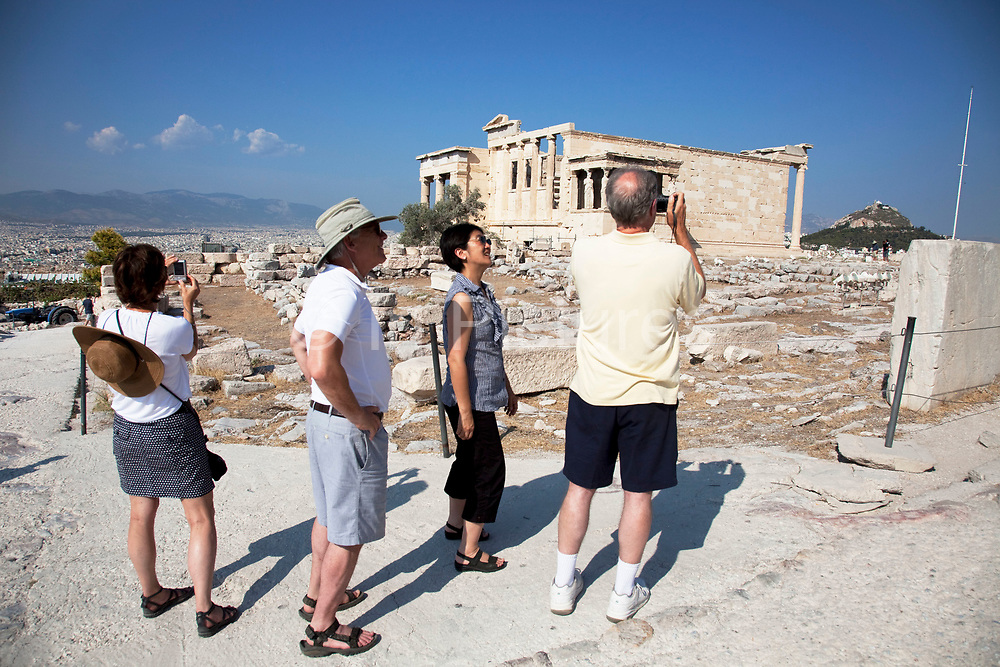 Tourists and visitors at the Acropolis of Athens. Athens is the capital and largest city of Greece. It dominates the Attica periphery and is one of the world's oldest cities, as its recorded history spans around 3,400 years. Classical Athens was a powerful city-state. A centre for the arts, learning and philosophy.