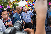 """09 MAY 2014 - BANGKOK, THAILAND:  SUTHEP THAUGSUBAN leads a march of anti-government protestors to Government House in the Dusit neighborhood of Bangkok. Thousands of Thai anti-government protestors took to the streets of Bangkok Friday to start their """"final push"""" to bring the popularly elected of government of Yingluck Shinawatra. Yingluck has already been forced out by a recent court ruling that forced her to resign and she is facing indictment by the National Anti Corruption Commission of Thailand for alleged improprieties related to a government rice price support scheme. The protestors Friday were marching to demand that she not be allowed to return to politics. The courts have not banned her party, Pheu Thai, which has formed an interim caretaker government to govern until elections expected in July, 2014. Suthep Thaugsuban, secretary-general of the People's Democratic Reform Committee (PDRC),  said the president of the Supreme Court and the new senate speaker, who would be selected Friday, should set up an """"interim people's government and legislative assembly."""" He went onto say that if they didn't, he would.    PHOTO BY JACK KURTZ"""