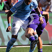 NEW YORK, NEW YORK - May 29:  Khiry Shelton #19 of New York City FC and Brek Shea #20 of Orlando City FC tangle as they challenge for the ball during the New York City FC Vs Orlando City, MSL regular season football match at Yankee Stadium, The Bronx, May 29, 2016 in New York City. (Photo by Tim Clayton/Corbis via Getty Images)