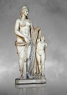 2nd century Roman statue of Venus known as the Venere Felice, inspired by the Hellenistic stsue of Aphrodite of Cnidus made by Greek sculptor Praixiteles in the 4th century BC. Possibly a Venus's face is a portrait of Sallustia who dedicated the statue with Helpidus, and the Eros may be a portrait of her young son. inv 129, Vatican Museum Rome, Italy,  grey art background ..<br /> <br /> If you prefer to buy from our ALAMY STOCK LIBRARY page at https://www.alamy.com/portfolio/paul-williams-funkystock/greco-roman-sculptures.html . Type -    Vatican    - into LOWER SEARCH WITHIN GALLERY box - Refine search by adding a subject, place, background colour, museum etc.<br /> <br /> Visit our CLASSICAL WORLD HISTORIC SITES PHOTO COLLECTIONS for more photos to download or buy as wall art prints https://funkystock.photoshelter.com/gallery-collection/The-Romans-Art-Artefacts-Antiquities-Historic-Sites-Pictures-Images/C0000r2uLJJo9_s0c