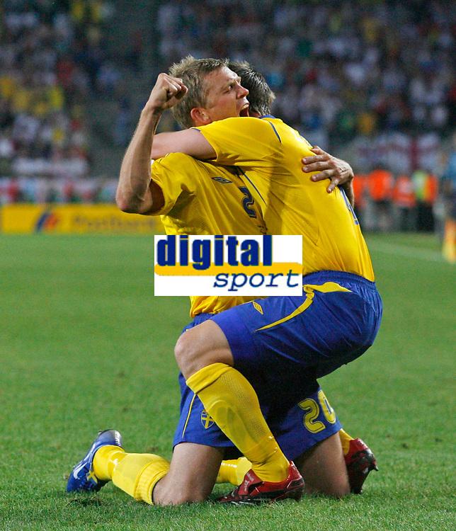 Photo: Glyn Thomas.<br />Sweden v England. FIFA World Cup 2006. 20/06/2006.<br /> Sweden's Marcus Allback (L) celebrates his equaliser.