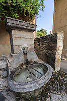 Pernes les Fontaines is a Vaucluse village of fountains, as its name suggests.  Many different styles of fountain can be found, some of which have been declared French National Monuments.  Most of the fountains were built during the 18th century.  Styles vary from moss-covered to tiny wash basins.  Some of the more interesting fountains are the Fountaine du Cours de la République, covered in calcium buildup and moss, the Fontaine du Cormoron at Place Cormoran, Fontaine Villeneuve, Fontaine d'Anges, and Fontaine Tour de Ferrande.