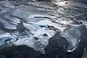 Floating icebergs as ice sculpture shapes in glacial water in South Iceland
