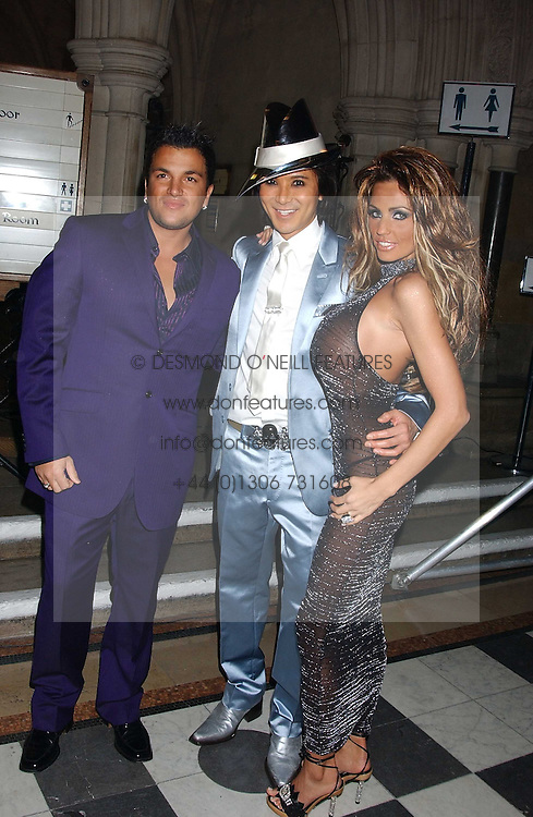 Left to right, PETER ANDRE, ANDY WONG and JORDANat Andy & Patti Wong's annual Chinese New Year party, this year celebrating the year of the dog held at The Royal Courts of Justice, The Strand, London WC2 on 28th January 2006.<br />