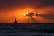 Mediterranean Sun Set, A sail boat crossing the sun. A sequence of 4 Progressive images