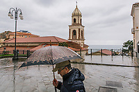 SANTA MARIA DI CASTELLABATE (CASTELLABATE), ITALY - 14 FEBRUARY 2018: A man walks in the main square of Santa Maria di Castellabate, the town home to Alessia d'Alessandro (28), the Five Stars Movement (M5S, Movimento 5 Stelle) candidate running for the Chamber of Deptuies in the 2018 Italian General Elections, in Santa Maria di Castellabate (Castellabate), Italy, on February 14th 2018.<br /> <br /> Santa Marina di Castellabate is part of the electoral college of Agropoli, in the Campania region (southern Italy) in which Franco Alfieri (Democratic Party, PD, Partito Democratico), politically active for the past 30 years, is running agains the 28-years old Alessia d'Alessandro (Five Stars Movement, M5S, Movimento 5 Stelle).<br /> <br /> The 2018 Italian general election is due to be held on 4 March 2018 after the Italian Parliament was dissolved by President Sergio Mattarella on 28 December 2017.<br /> Voters will elect the 630 members of the Chamber of Deputies and the 315 elective members of the Senate of the Republic for the 18th legislature of the Republic of Italy, since 1948.Santa<br /> <br /> The 2018 Italian general election is due to be held on 4 March 2018 after the Italian Parliament was dissolved by President Sergio Mattarella on 28 December 2017.<br /> Voters will elect the 630 members of the Chamber of Deputies and the 315 elective members of the Senate of the Republic for the 18th legislature of the Republic of Italy, since 1948.