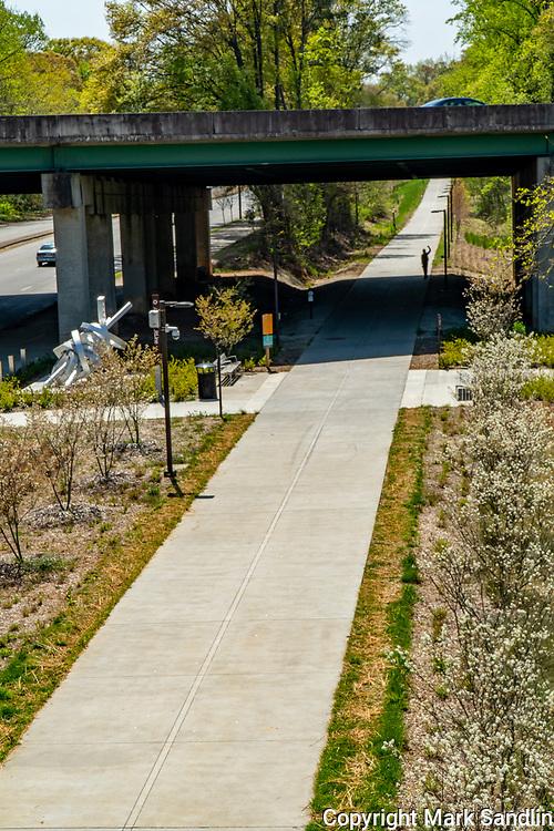 Lone walker along the Atlanta Beltliine Westside near mile marker 1.25 as the Beltline crosses underneath I-20