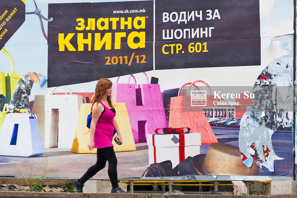 Street view, girl with commercial, Skopje, Republic of Macedonia, Europe
