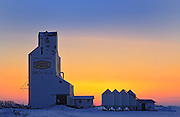 Grain elevator  and bins at sunset<br /> Birch Hills<br /> Saskatchewan<br /> Canada