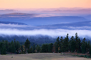 Clouds at sunrise over hills from the rim of Crater Lake, Crater Lake National Park, Oregon