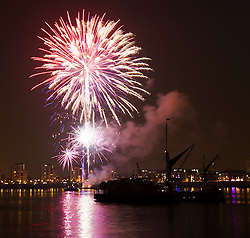 © Licensed to London News Pictures. 06/09/2014. London, UK. Fireworks explode next to tall ships on the River Thames in Woolwich for the Royal Greenwich Tall Ships Festival 2014 on the evening of 6th September 2014. The Royal Greenwich Tall Ships Festival takes place in London from 5-9 September 2014.  Photo credit : Vickie Flores/LNP