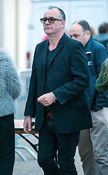 © Licensed to London News Pictures. 21/08/2015. Weston-super-Mare, North Somerset, UK.  Adrian Utley from the band Portishead arrives for an evening party at Banksy's Dismaland. Guests arrive for an evening party at BANKSY's Dismaland show at the old Tropicana on Weston seafront. Photo credit : Simon Chapman/LNP