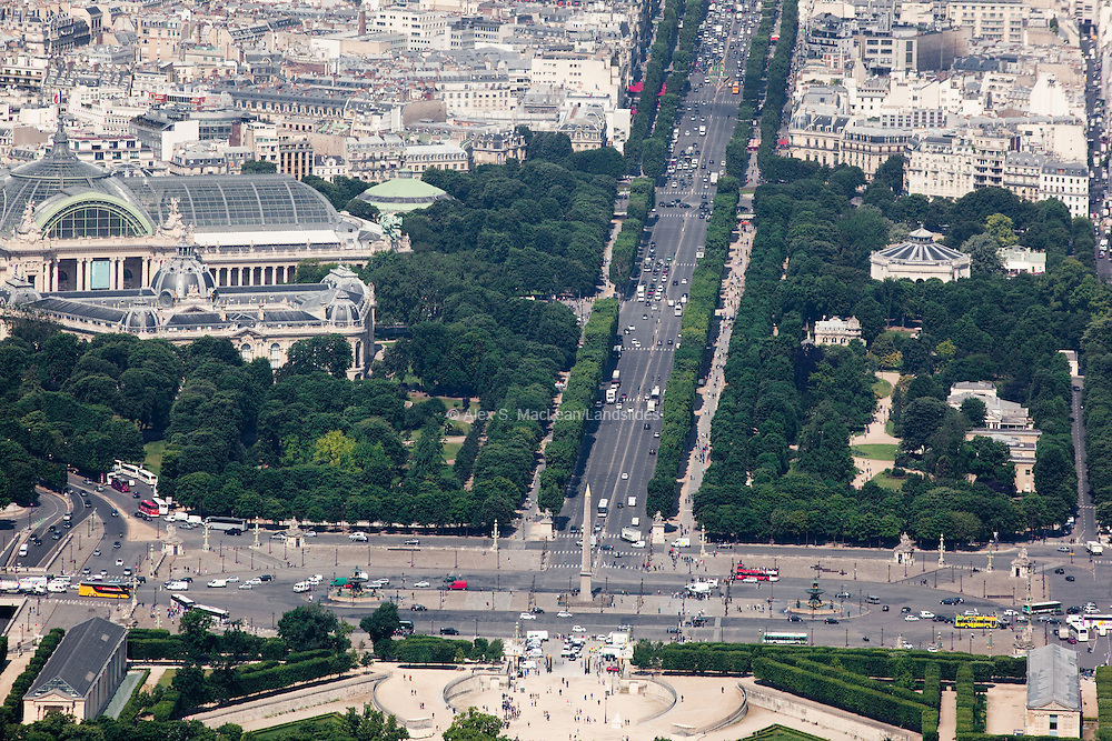 Looking down the Champs-Elysees towards the Arc du Triomphe with the Grand Palais (exhibition hall built in 1900) on the left.