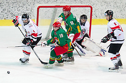 Berhard Fechtig of Austria vs Laisvydas Rimkus of Lithuania during the ice hockey match between National teams of Lithuania (LTU) and Austria (AUT) at 2011 IIHF World U20 Championship Division I - Group B, on December 12, 2010 in Ice skating Arena, Bled, Slovenia.  (Photo By Vid Ponikvar / Sportida.com)