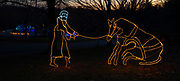 Lights create the outline of a stubborn mule being helped as dusk falls at The Way of Lights holiday light display at the National Shrine of Our Lady of the Snows in Belleville on December 3, 2019.  This is the 50th anniversary of the annual light display, which runs from 5 pm to 9 pm through December 31. <br />Photo by Tim Vizer