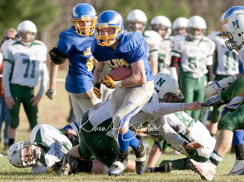 Gilford's senior running back Brandon Murphy breaks through Newfound's defense for yardage during the semi final NHIAA Division VI game.  The Eagles 41-0 win over Newfound will put them in the final state championship game against the Newport Tigers next Saturday at the Meadows Field.  (Karen Bobotas/for the Laconia Daily Sun)