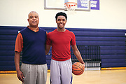 Harrison Ingram poses for a photo with his father, Tyrous Ingram, after practice at St. Mark's School of Texas in Dallas, Texas on December 6, 2017. (Cooper Neill for The Undefeated)