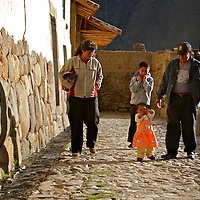 Americas, South America, Peru, Ollanta. Local family walks the Incan street of Ollanta.