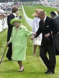 The Queen Mother is escorted by the Duke of Edinburgh as she arrives at Epsom racecourse for the Vodaphone Derby.