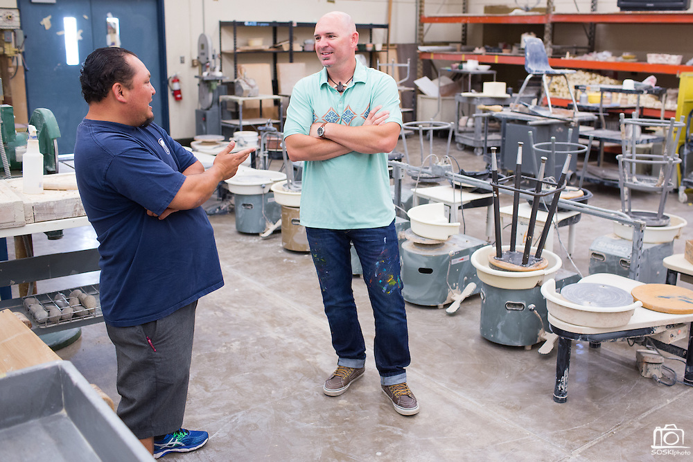 Ceramics teacher Jeff Albrech, right, talks with parent Kevin Balsbaugh during Milpitas High School's Back to School Night at Milpitas High School in Milpitas, California, on September 1, 2015. (Stan Olszewski/SOSKIphoto)