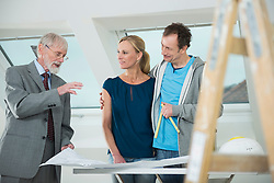 Architect and couple at construction site of new building
