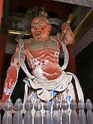 Japan, Tochigi, Nikko, Tosho-gu shrine The red guardian wooden sculpture