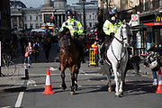 Extinction Rebellion climate change action continues and mounted police walk along Whitehall as sites around Westminster are blocked on 8th October 2019 in London, England, United Kingdom. Extinction Rebellion is a climate group started in 2018 and has gained a huge following of people committed to peaceful protests. These protests are highlighting that the government is not doing enough to avoid catastrophic climate change and to demand the government take radical action to save the planet.