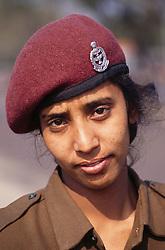 Portrait of female police officer in Delhi; India,