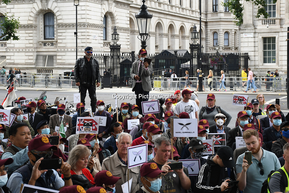 2021-07-31 Downing Street: Hundreds of British Gurkha veterans are protesting against the British government's discrimination, the exploitation of grave human rights violations and Betraytal. That Gurkha soldiers have been fighting for equality of rights with the British government for more than three decades as English soldiers have been ignored outside Downing Street, London, UK.