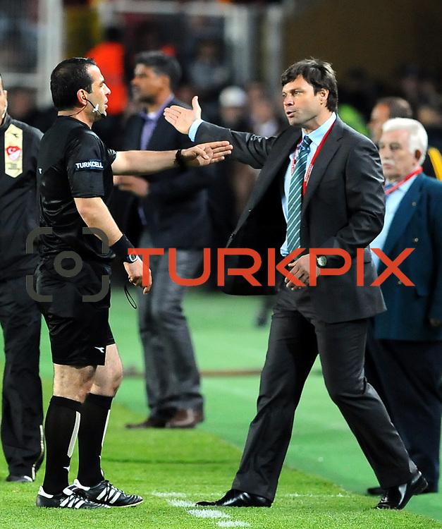 Referee's Bunyamin GEZER (L) and Bursaspor's coach Ertugrul SAGLAM (R) during their Turkish Super League soccer match Galatasaray between Bursaspor at the AliSamiYen Stadium at Mecidiyekoy in Istanbul Turkey on Sunday 25 April 2010. Photo by TURKPIX