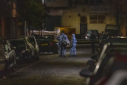 © Licensed to London News Pictures. 19/01/2020. London, UK. Police forensic investigators gather at the crime scene as an investigation is launched into the deaths of three men in Redbridge, all of whom had suffered apparent stab injuries. Photo credit: Peter Manning/LNP