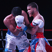 Josue Vargas of Puerto Rico (R) punches Carlos Winton Velasquez of Nicaragua during the Puerto Rico vs The World boxing event at Orlando Live Events Center on Friday, March 24, 2017 in Casselberry, Florida.  (Alex Menendez via AP)