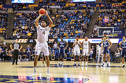 Dec 1, 2019; Morgantown, WV, USA; West Virginia Mountaineers guard Miles McBride (4) shoots a free throw after a technical foul during the second half against the Rhode Island Rams at WVU Coliseum. Mandatory Credit: Ben Queen-USA TODAY Sports