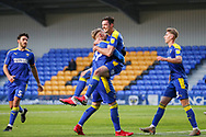 AFC Wimbledon defender Ben Heneghan (22) celebrates scoring during the EFL Sky Bet League 1 match between AFC Wimbledon and Bristol Rovers at Plough Lane, London, United Kingdom on 5 December 2020.