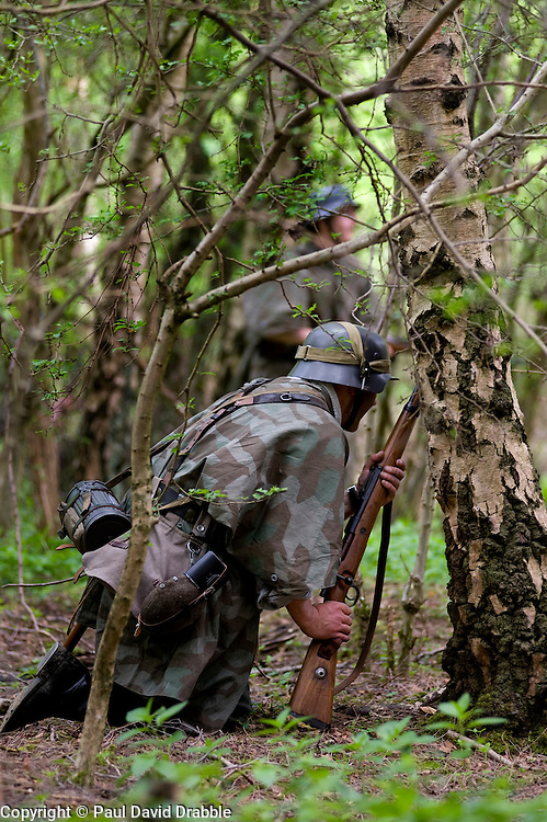 Reenactors from Northern World War Two Association, dressed as elements of the Elite Gross Deutschland Division advance allied positions during a private 24hr excerise, held at Sutton Grange, near Ripon in Yorkshire 15  May 2010 .Images © Paul David Drabble.