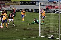 Bolton Wanderers Arthur Gnahoua scores his side's third goal  beating Mansfield Town's Aidan Stone<br /> <br /> Photographer Mick Walker/CameraSport<br /> <br /> The EFL League 2 - Mansfield Town v Bolton Wanderers  - Wednesday 17th February  2021 - One Call Stadium-Mansfield<br /> <br /> World Copyright © 2020 CameraSport. All rights reserved. 43 Linden Ave. Countesthorpe. Leicester. England. LE8 5PG - Tel: +44 (0) 116 277 4147 - admin@camerasport.com - www.camerasport.com