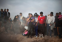 Friends and family at a funeral for a group of teenagers who were killed at a birthday party massacre in Ciudad Juarez.