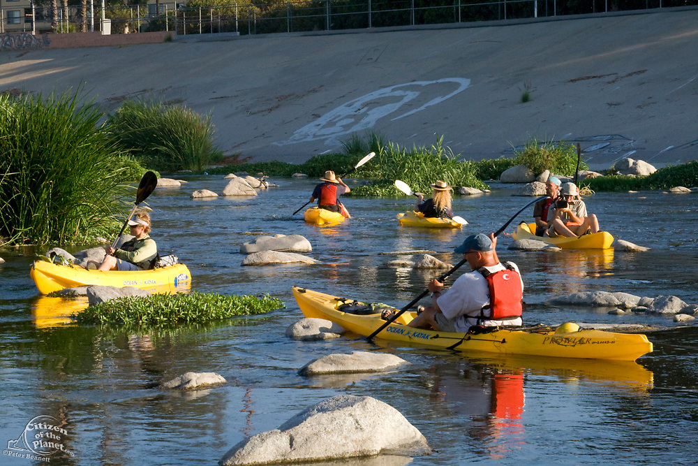 """Day 2 of the Los Angeles River Expedition 2008. Organized by LA river kayaker and LaLa Times publisher George Wolfe, boaters embarked on a 52-mile exploration of the full river, from its source (Canoga Park) to its estuary (Long Beach). Deemed not to be a """"traditional navigable water"""" by the Army Corps of Engineers — and therefore not worthy of clean water standards, the Expedition's purpose is to prove it is navigable. Glendale Narrows, Los Angeles County, California, USA."""